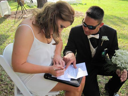 Witnesses signing the marriage license at Black Diamond Ranch Country Club wedding ceremony